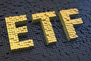 Gold blocks on black background, spelling out ETF