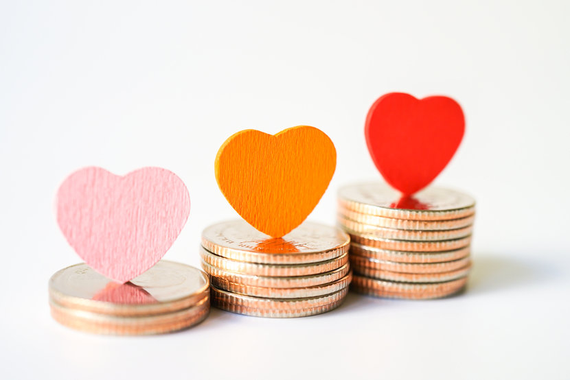 Stacks of gold and silver coin gifts, with various felt hearts sitting on top