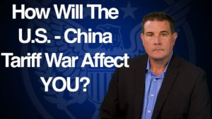 USMR sales manager sits in front of blue background with text overlay that says How will the US-China tariff war affect you
