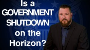 Photo of sales manager from USMR in front of blue background that reads: Is a Government Shutdown on the Horizon?