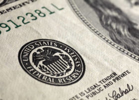 Super close up macro image of American one hundred dollar bill, focus on the seal