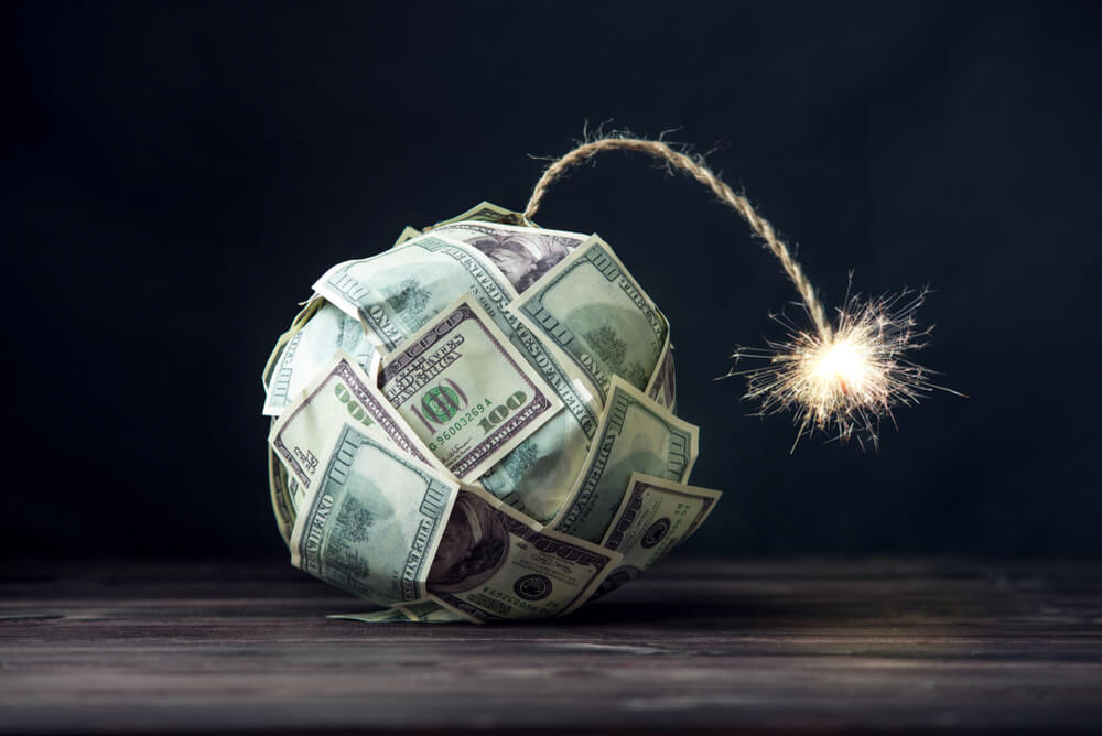 Big-bomb-of-money-hundred-dollar-bills-with-a-burning-wick.-Little-time-before-the-explosion.-The-concept-of-financial-crisis