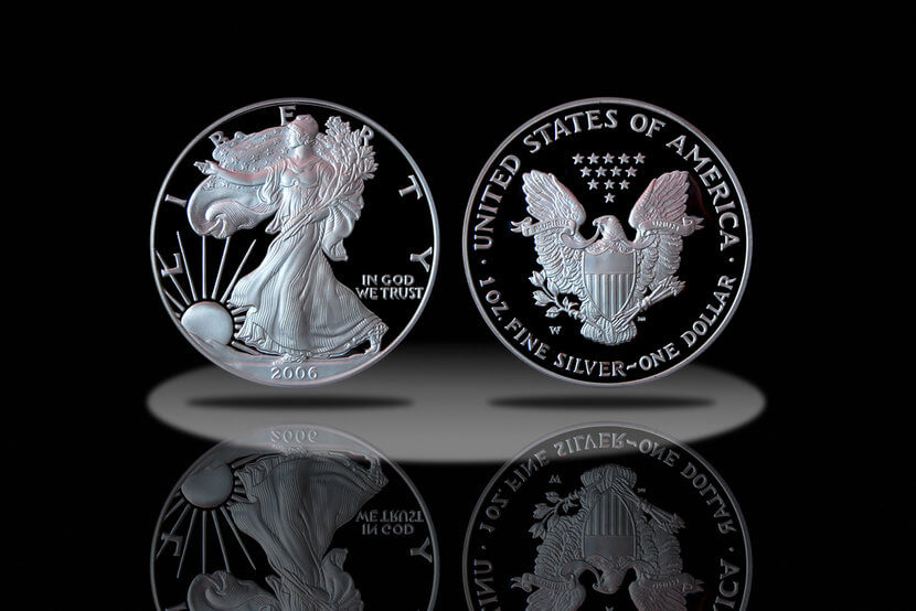 Proof American Silver Eagle Coin spotlighted on black