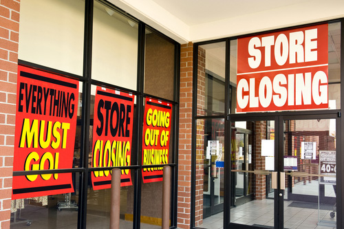 Everything must go store closing signs on business window