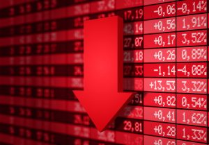 Volatile stock market charts with red arrow pointing down