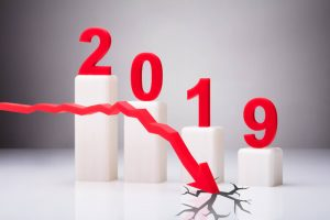 2019 with red arrow descending and cracking ground