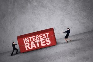 business people fighting against interest rates