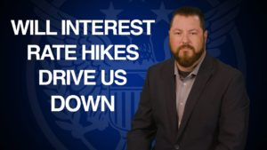 """next to Patrick Brunson infront of blue u.s. seal """"will interest rate hikes drive us down"""""""