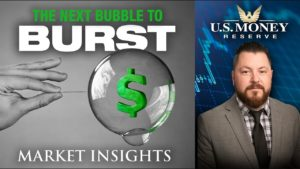 patrick brunson presenting next to a clear bubble with a green dollar sign inside infront of a grey background