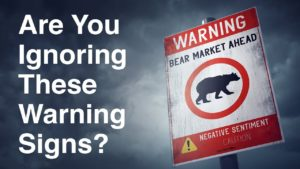 cloudy skies background with a road sign warning or an upcoming bear market