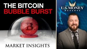 "red bitcoin inside bubble with text that says ""the bitcoin bubble burst"" presented by U.S. Money Reserve's Patrick Brunson"