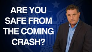 "blue background with text that says ""are you safe from the coming crash?"" presented by Coy Wells"