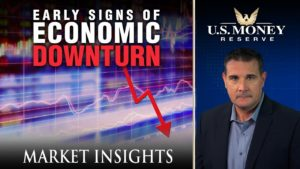 Coy Wells presenting signs of an economic downturn with a display of a purple graph and a red negative arrow