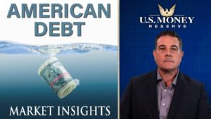 coy wells presenting next to american dollar bills in a roll drowning in a sea of debt
