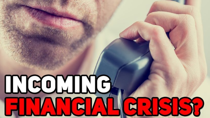 "man making a serious phone call with alarming text that says ""incoming financial crisis?"""