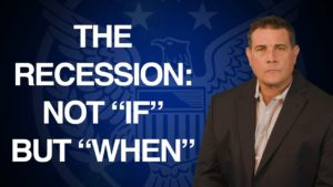 coy wells in front of blue u.s. seal presenting market insights about the coming recession