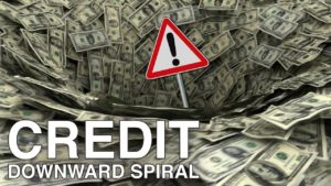 "Background of money in tunnel shape with text that says""credit downward spiral"""