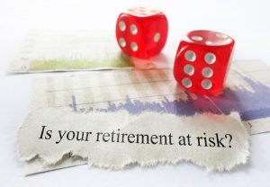 Retirement risk news headline with dice and stock market charts