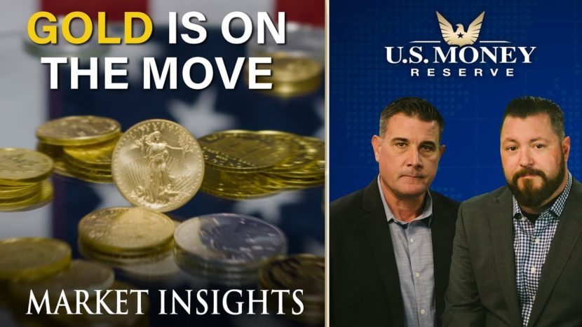 coy wells and patrick brunson presenting together next to stacks of gold coins surrounding a silver coin