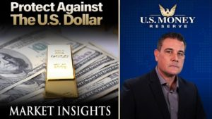 Patrick Brunson presenting next to a gold bar on top of American dollar bills