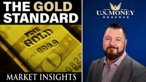 patrick brunson presenting next to a yellow gold bar for market insights