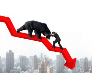 Graphic that represents a recession with a bear crawling down a trend line over a city skyline