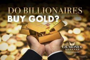 Gold bars in business man's hands under the question, Do billionaires buy gold?