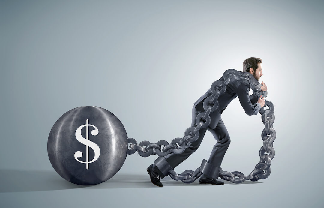 Man Pulling a Financial Ball and Chain
