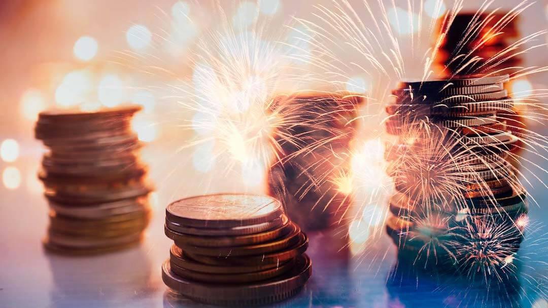 Fireworks over stacks of coins
