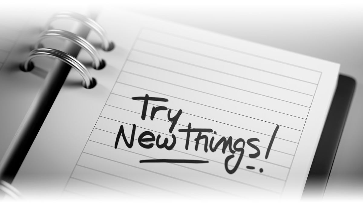 Try New Things Written on Notebook