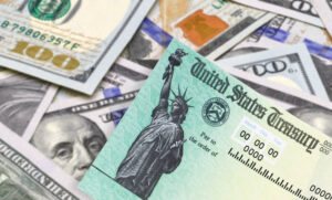 United States Treasury check, ssn card with US currency.