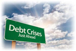 "Roadside sign reading ""Debt Crises Just Ahead"""