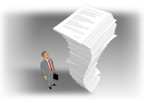 Business man looking up at towering stack of paper